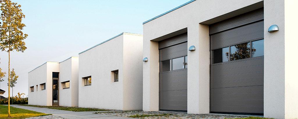 White building with brown garagedoors header