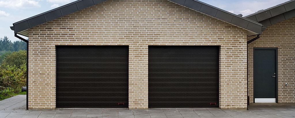 Black NASSAU Garage door header new logo
